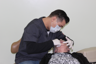 Dr. Sigi extracting teeth from a patient.